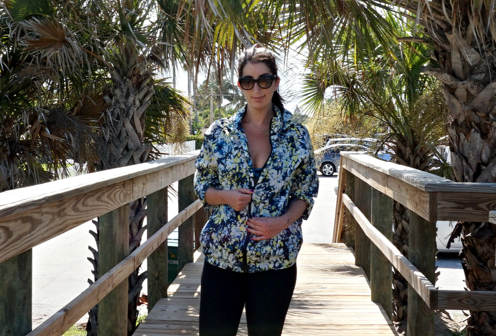 Rain Jacket, courtesy of FatFace. Leggings, Courtesy of Marshalls. Sunglasses, Prada. Shot on location in Florida.