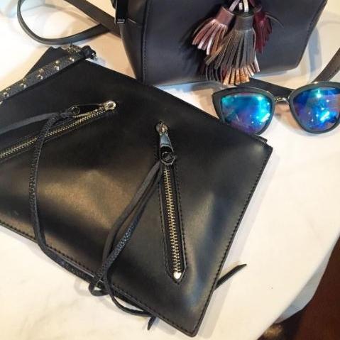 Rebecca Minkoff leather clutch; Quay Australia sunglasses.