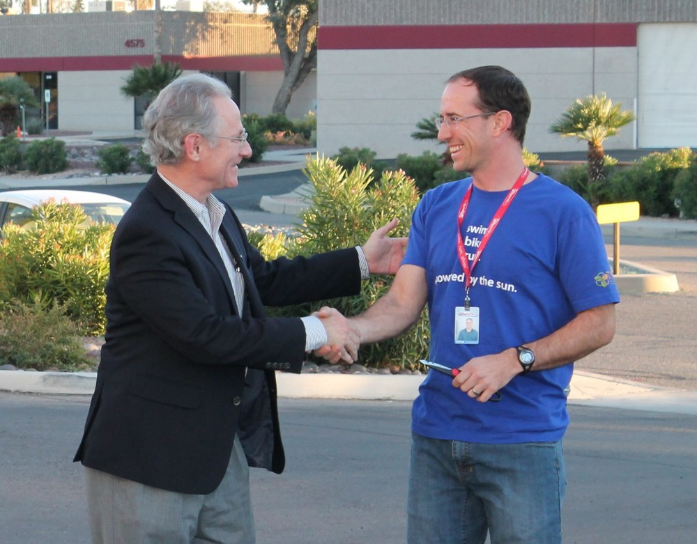 Tucson's Mayor Rothschild congratulates the owner of Trisports.com on their solar system which produces up to 100% of their monthly electrical needs.