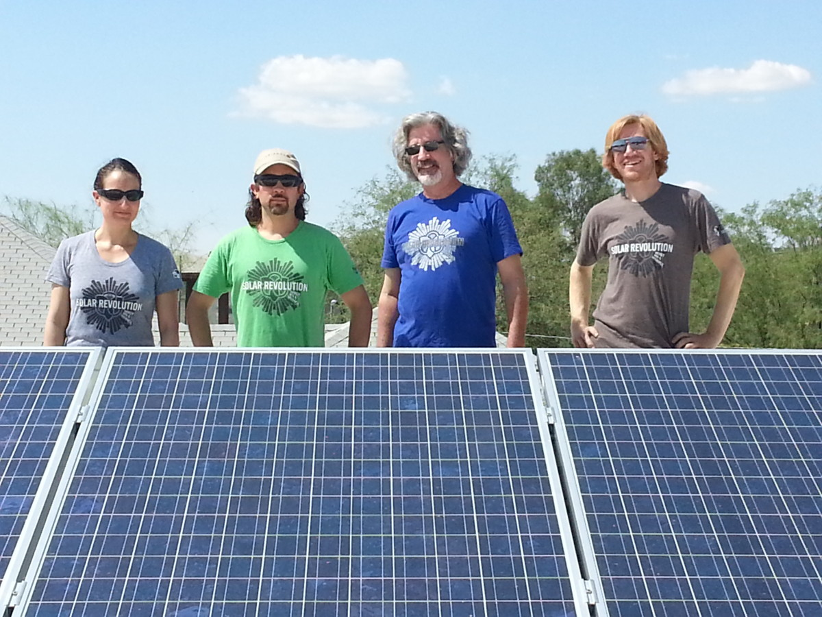 Erika, Tamarack, Mat and Bobby from the TFS Family model with our solar panels!
