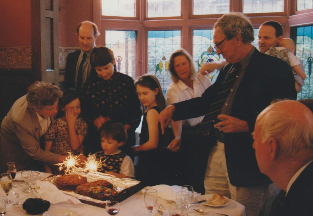 Granddaughter Amy, then 4, in front of Marcelle and Barry's anniversary cake. Marcelle, is leaning over with the knife. Marcelle's husband, Barry, is wielding a camera at front. Chris is holding the baby. Amy is now 22 and studying law at Monash University.