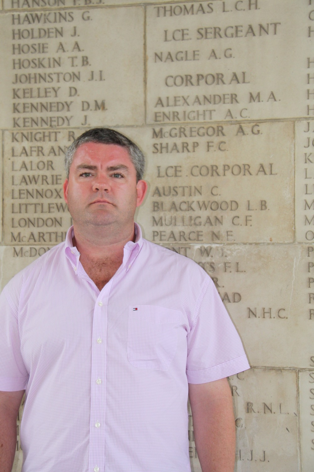 David Harris, in front of the memorial commemorating his grandfather Athol Nagle, the first Australian killed in Malaya.