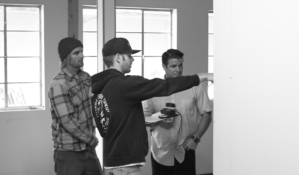 Nick Pavlina, Scott Pavlina and Ryan Grable making sketches of potential floor plans in downtown Soquel