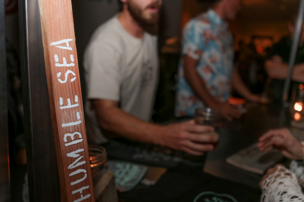 Cam and Taylor holding down the fort, serving our Vienna Lager and barrel aged brown like the world was ending. Photo by  Santa Cruz Waves