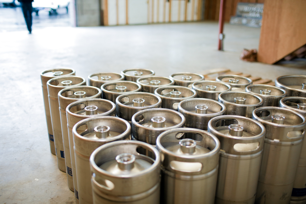 A few of our empty kegs stored at our new location on Swift St.