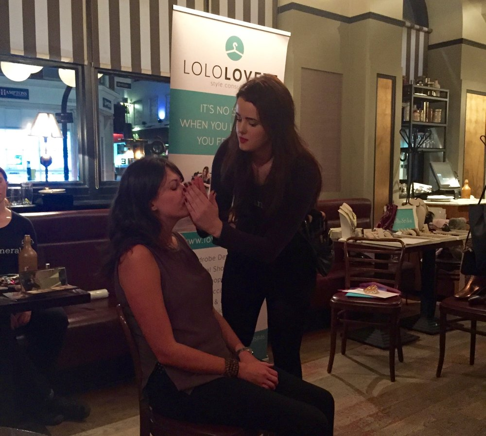 Bare Minerals Make-up Artist Lucy, showing an attendee how to liven up her skin