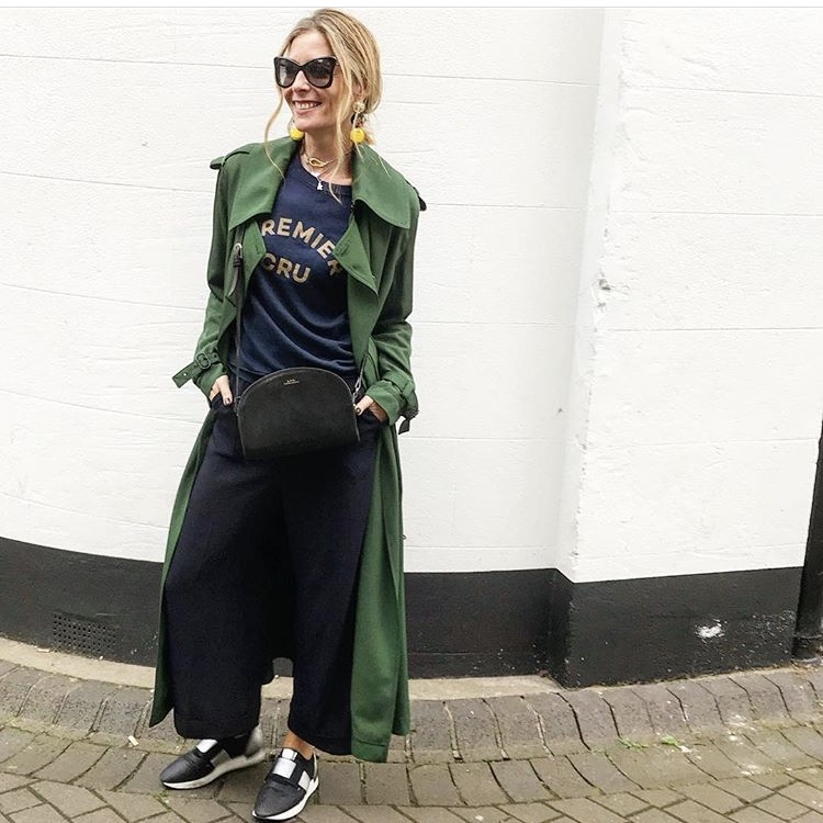 A duster coat dresses up a simple t-shirt and trainers combination. Culottes lend the outfit a trendy edge but jeans would work just as well if you're not as brave!