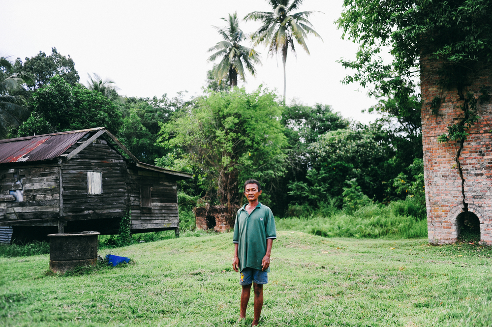 Zulkifly Mat Zain, 55, is the son of the town's former locomotive operator. He stands by his relative's home.