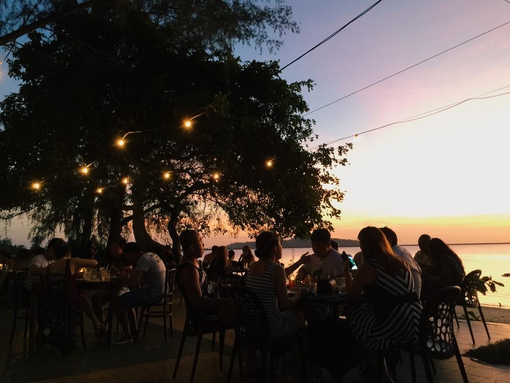 Sunset dinner by the shoreline.