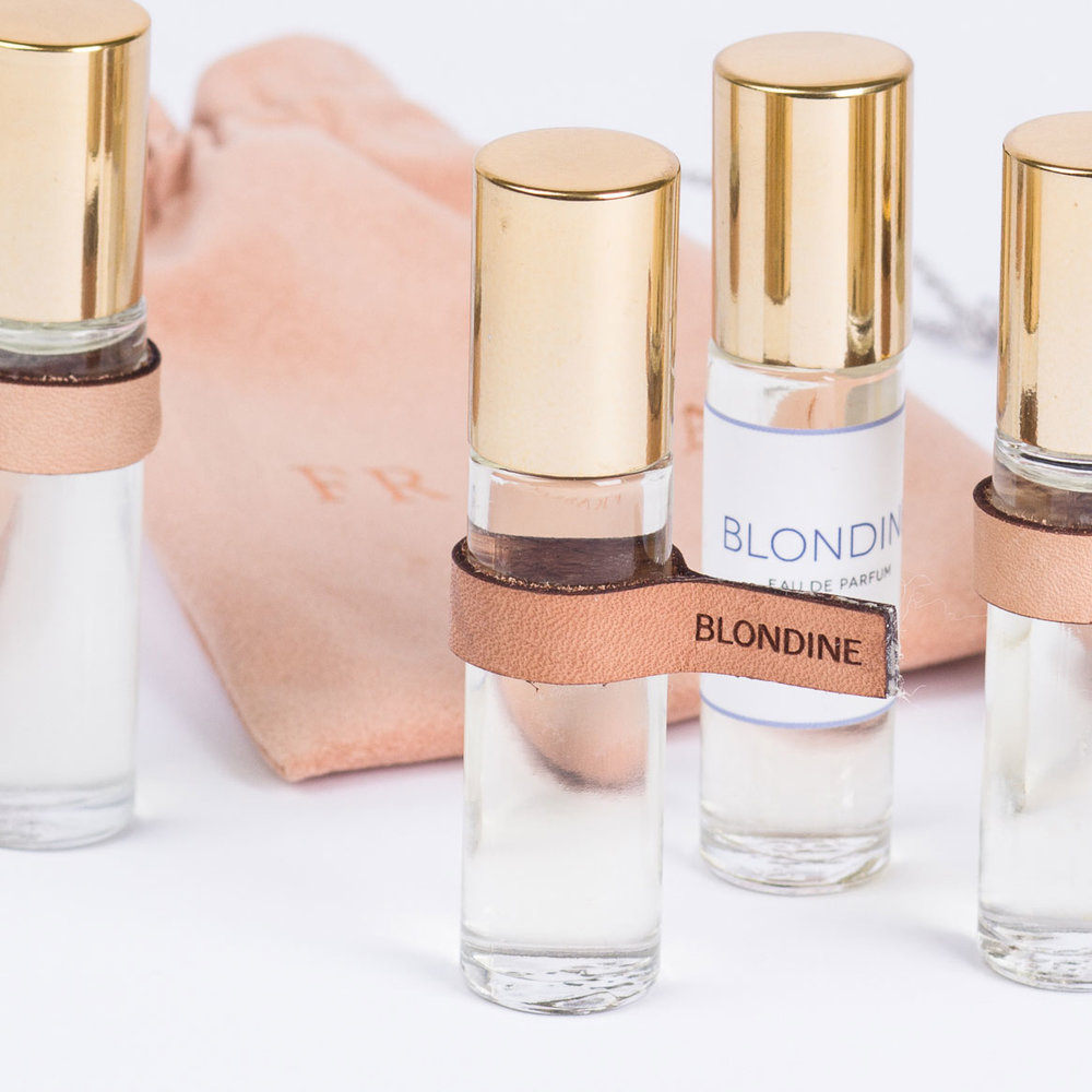 BLONDINE    EAU DE PARFUM TOUCH POINT   SIZE : 0.34OZ / 10ml   US WHOL : $17.50   US SRP : $35.00   Application :roll on perfume   Packaging : glass with roll on applicator, gold metal cap, leather tag, comes in a suede pouch