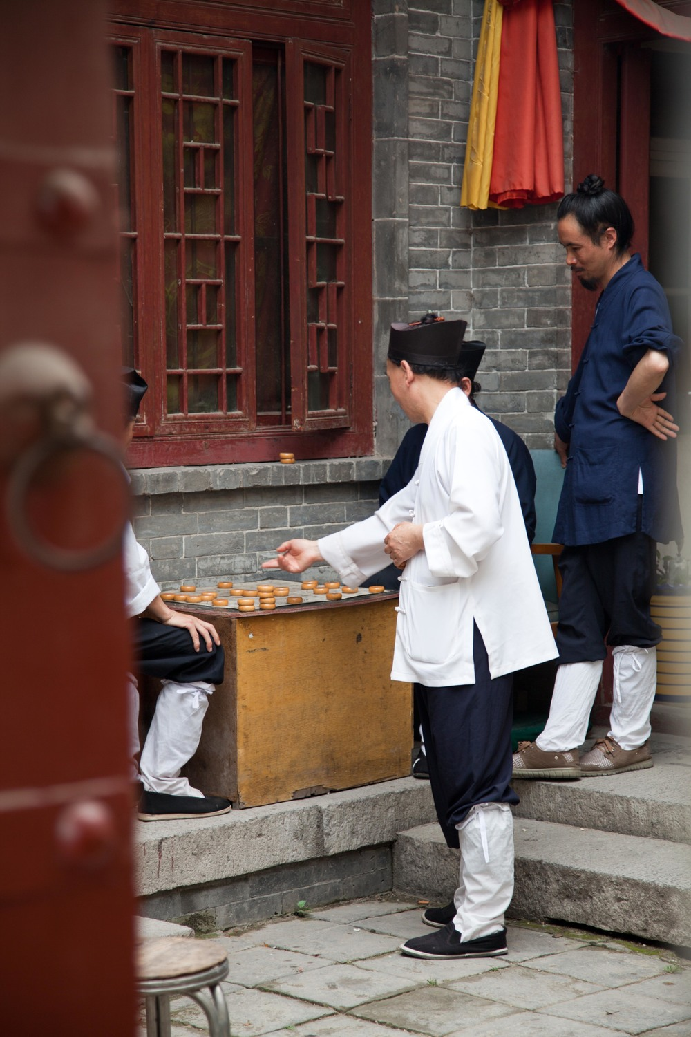 Employees at the temple playing a game - Xian