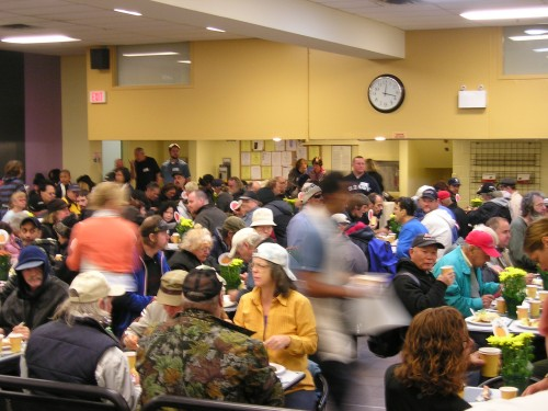 This is what the dining room looked like this past Thanksgiving, for the special meal. For special meals, we have volunteers serving the guests – like a restaurant rather than the usual cafeteria style. The Centre served about 1,500 Thanksgiving meals. The total meals number of meals served that day was close to 2,000. (Our average right now is about 1,200 meals per day.)