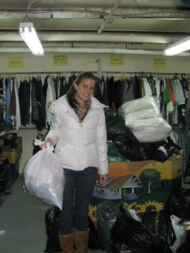 Jennifer dropping off bags in the clothing room.