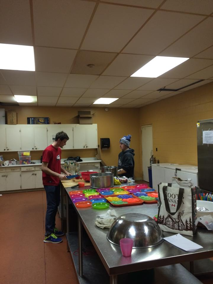 Interns hard at work making a snack for the kids.