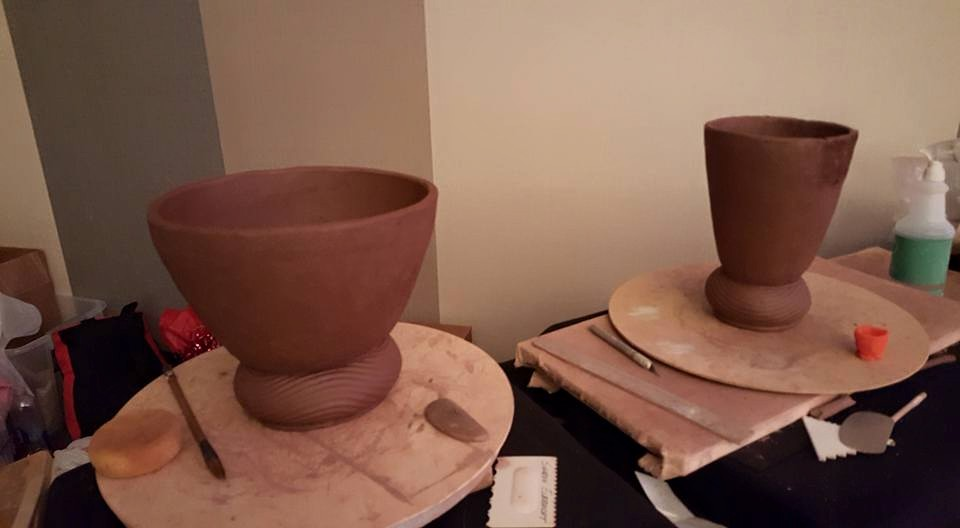 The two pieces almost completed during the conference.  The participants were also given mini-tubs of Pla-Dough.  The little orange pot is courtesy of my friend Will.