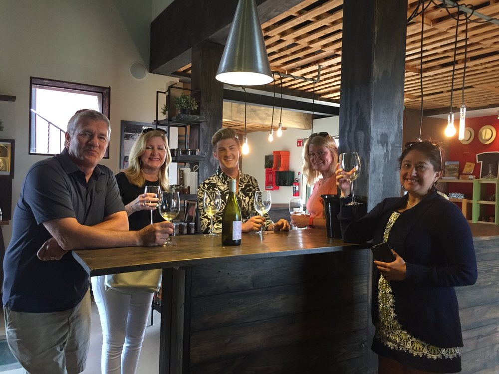 Our guests having a great time trying some white wine in Valle de Guadalupe