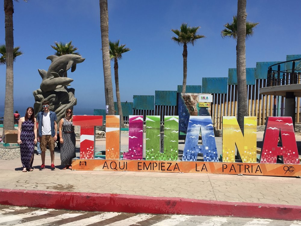 Our guests standing next to the famous Tijuana sign