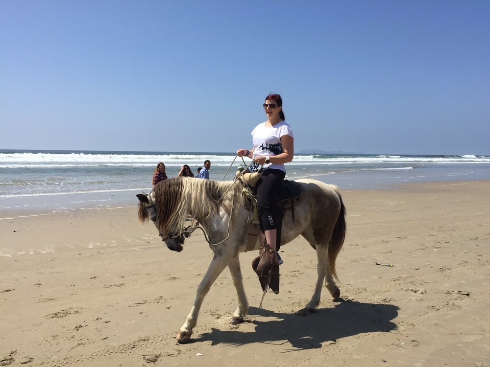 Our guest having a great time riding a horse on Playas de Tijuana!