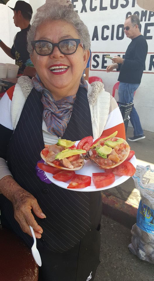 Owner and Chef, Sabina Bandera, serving her famous tostadas! Photo Credit: La Guerrerense