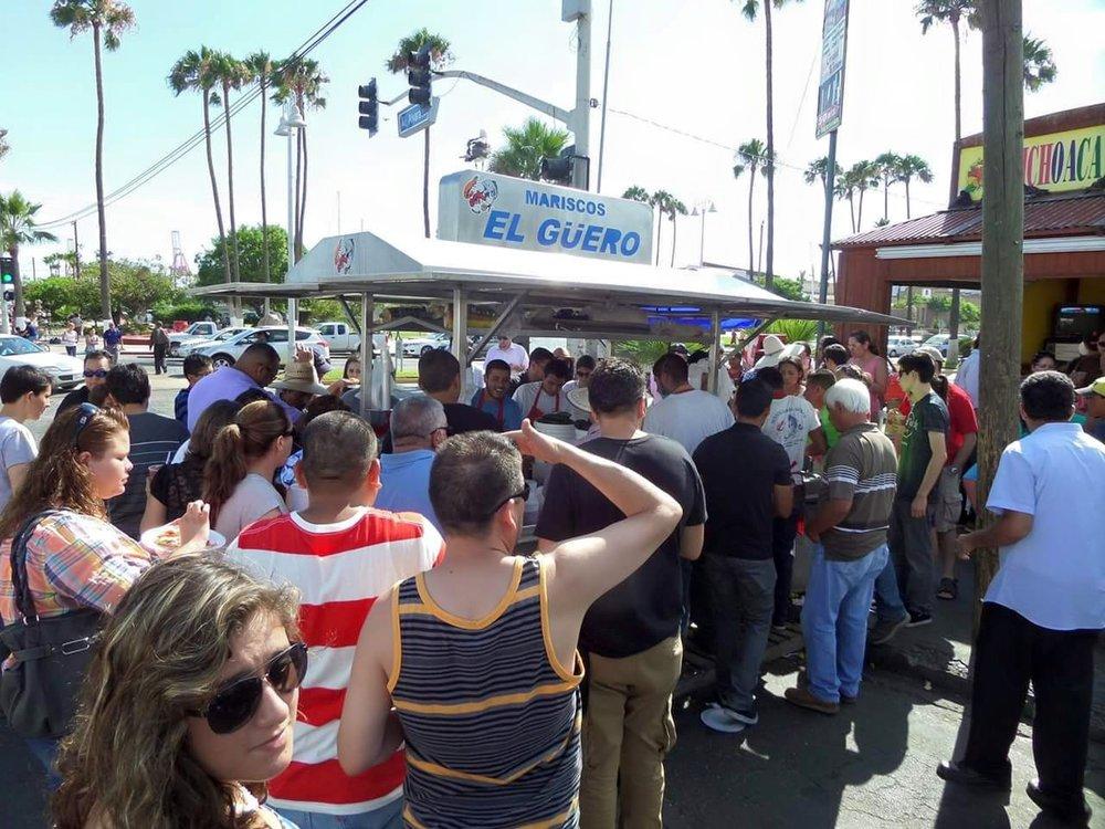 The busy Mariscos El Guero food cart. Photo credit: Mariscos El Guero