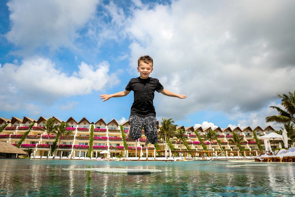 A kid enjoying himself at the pool. Photo credit: Grand Velas Riviera Maya