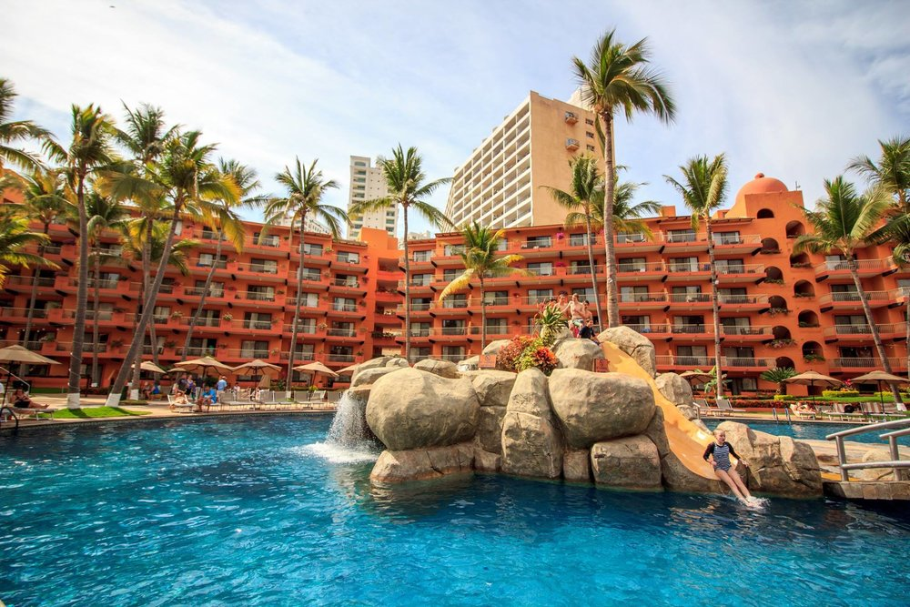 Kids can start off their vacation by sliding into the play pool! Photo Credit: Villa del Palmar Puerto Vallarta