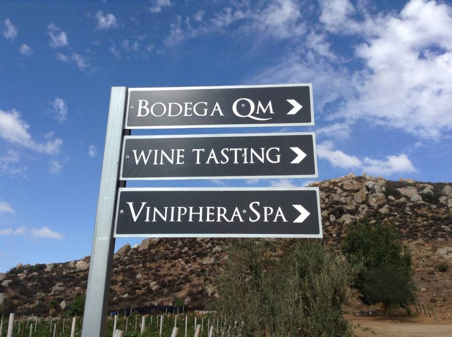 Signs to the Winery, wine tasting room, and Viniphera spa. Photo credit: Airbnb