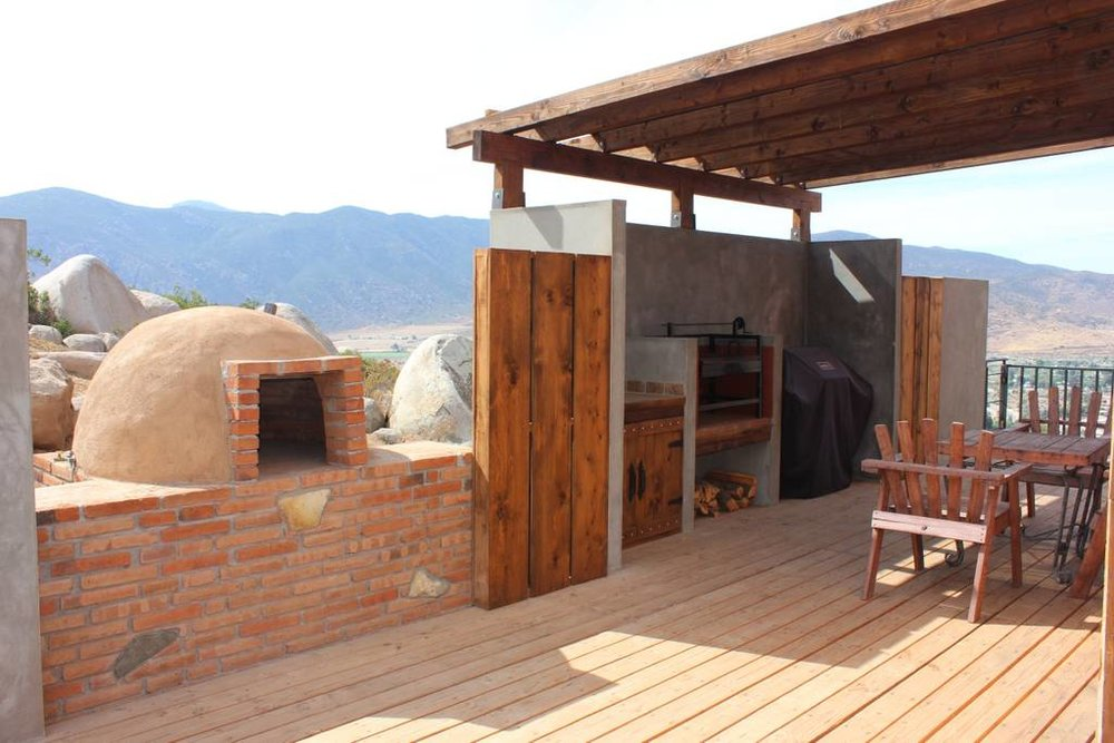 One of the few outdoor areas on Casa Laurel with the best BBQ and pizza oven equipment! Photo credit: Airbnb