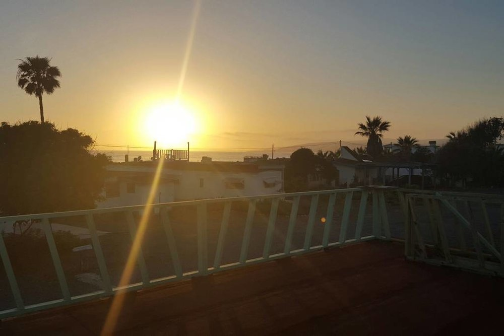 Sunset from the rooftop terrace. Photo credit:  Airbnb