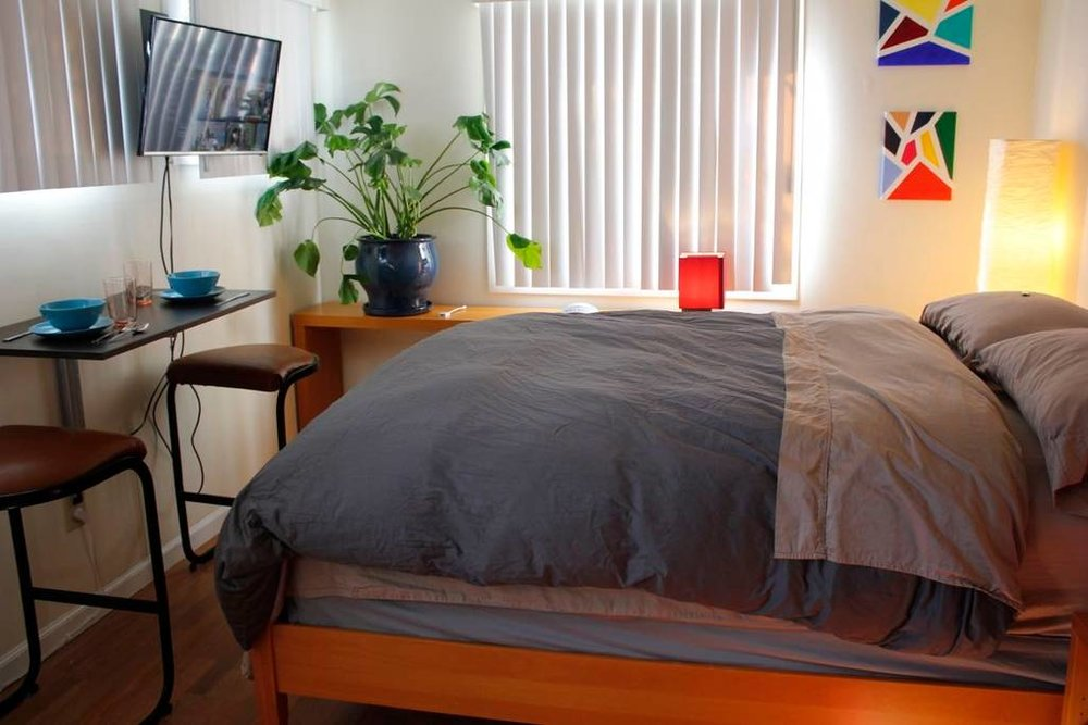 Private studio bed and amenities. Photo credit:  Airbnb