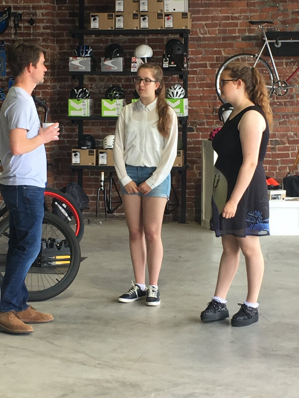 Miranda Pauw (center) and Kristel Buurmans (right) chat with Curtis Klein at his bicycle shop Wabi Cycles in the Brady Arts District.