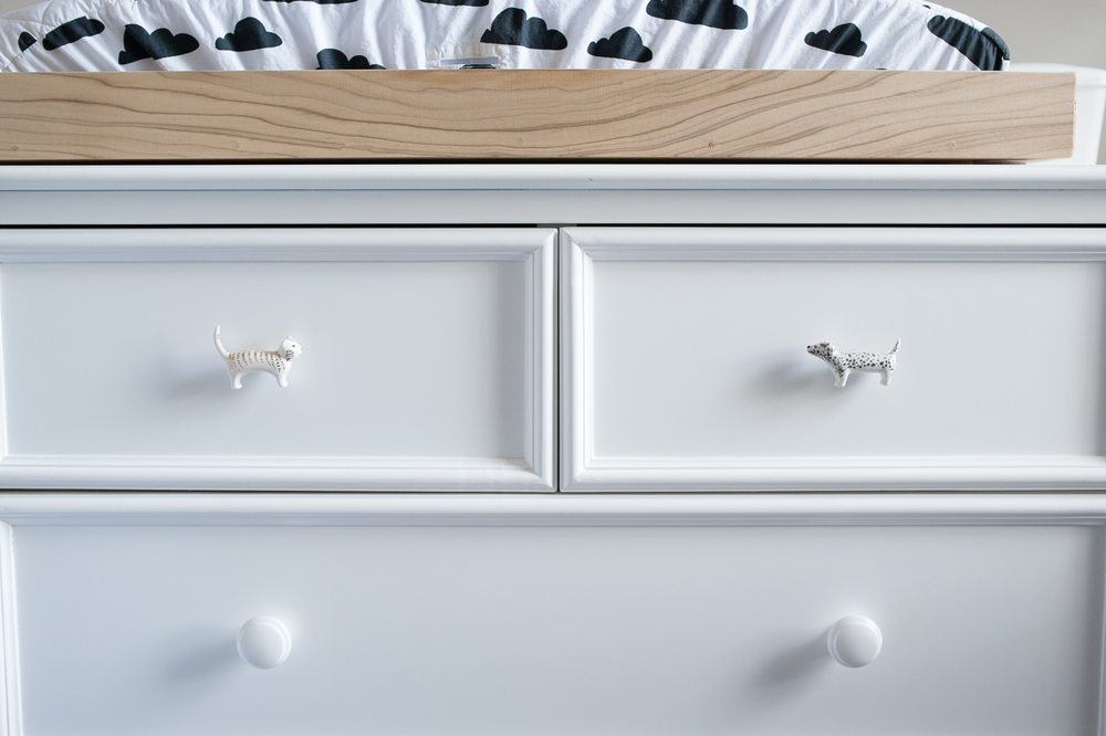 16.  cloud changing pad cover from Land of Nod , 17.  puppy and kitty drawer pulls from Anthropologie