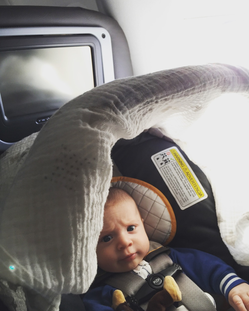 Miles's 1st plane ride - he handled international travel like a trooper!