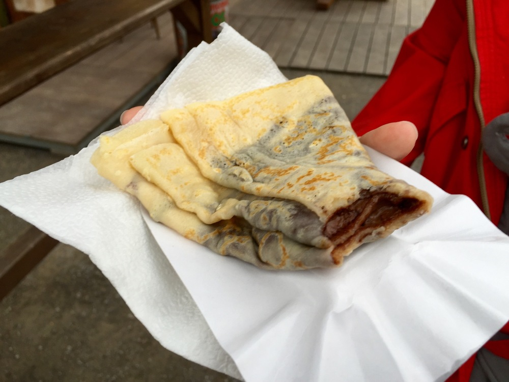 Enjoying a nutella crepe at the fair.