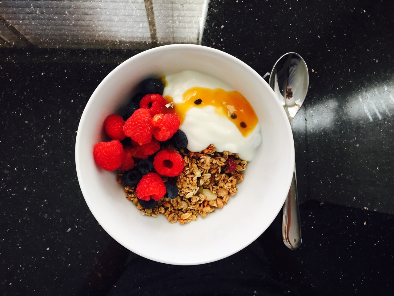 Berry Breakfast Pumpkin seed and almond granola with berries, yogurt and a little passionfruit- too good.  //SHE