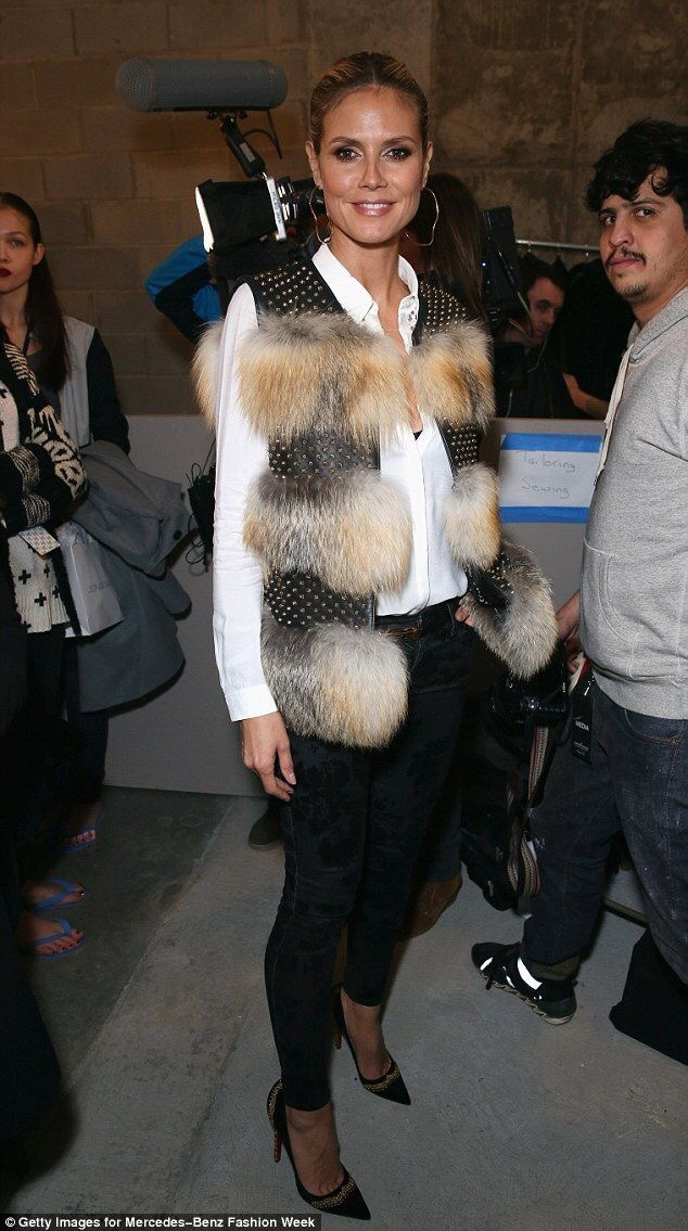Furry Flashback Heidi Klum before the Kenneth Cole Autumn/Winter 2013 Show at New York Fashion Week- Style on point. Love the leather waistcoat with gold stud details and fur panels. //SHE