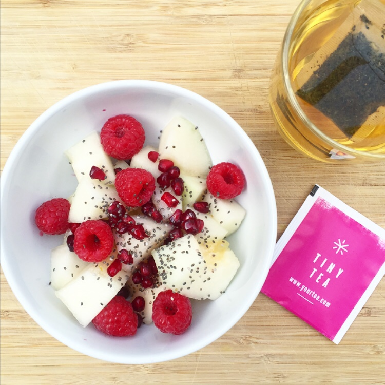Saturday AM Fresh melon, pomegranate and raspberries with chia seeds and Your Tea's Tiny Tea to start my Saturday! S H E