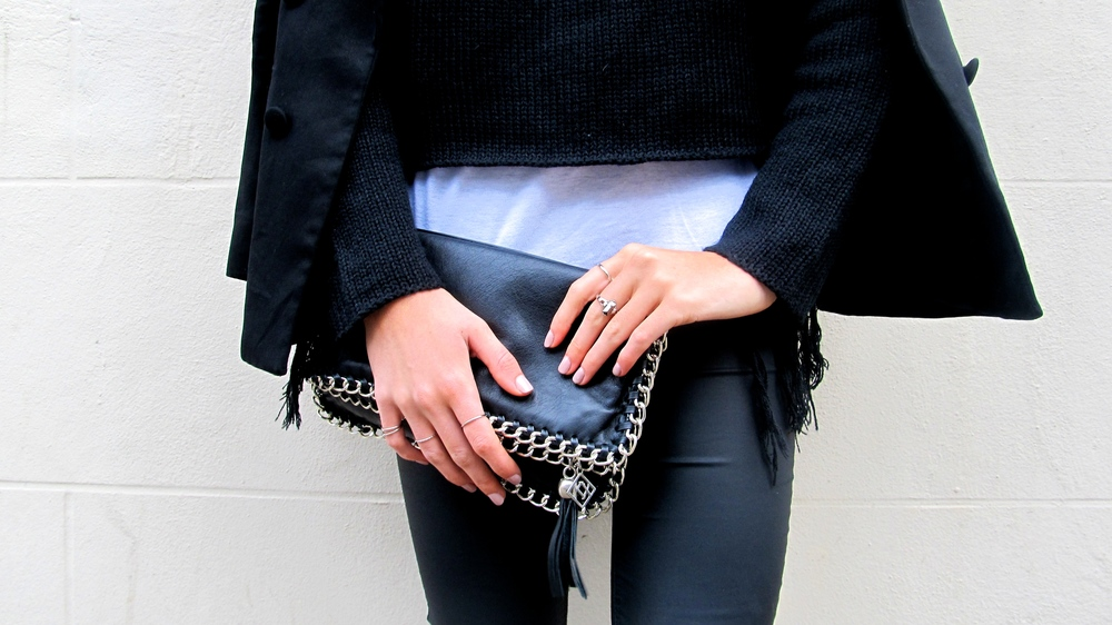 Stella McCartney chain clutch with Forever 21 rings.