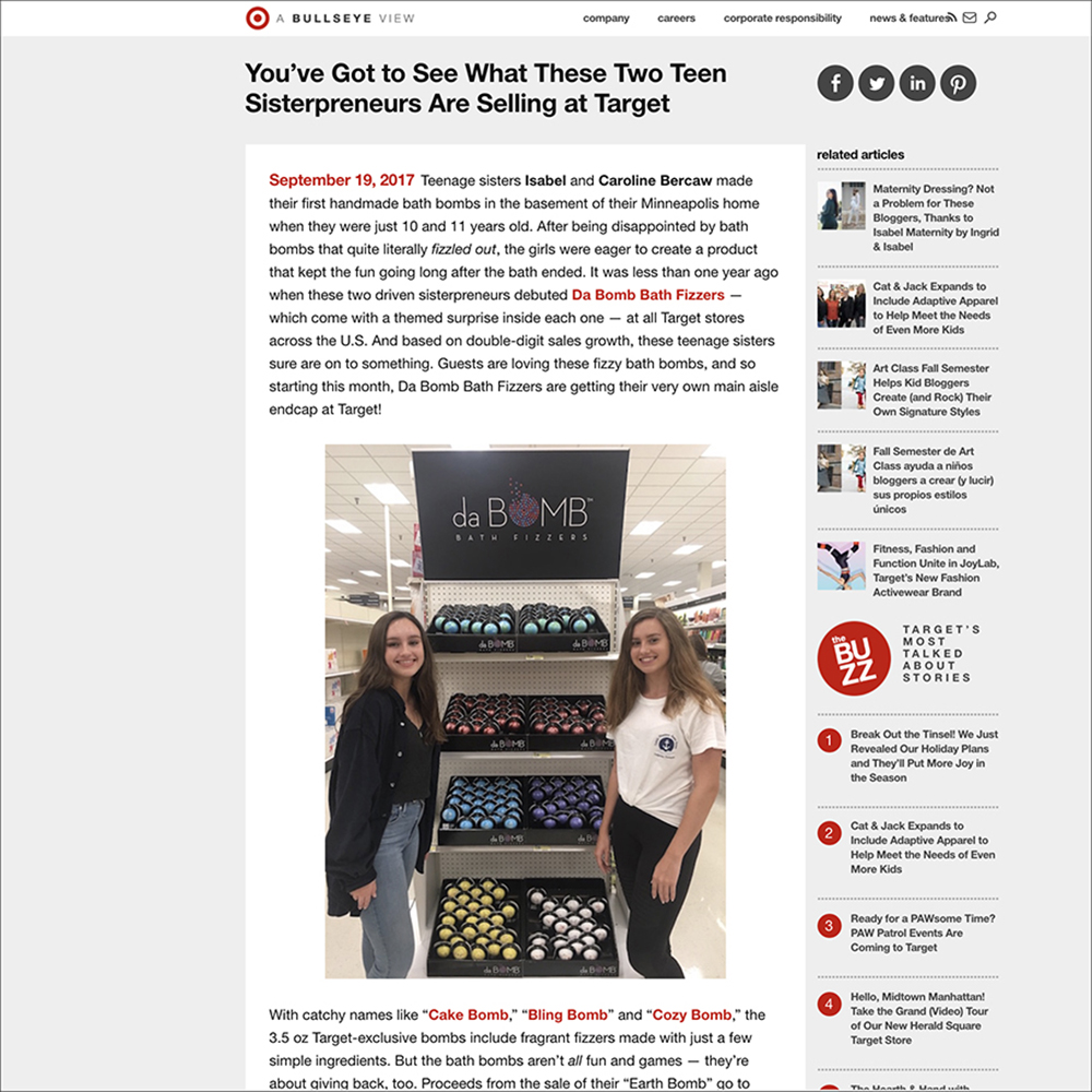 Teen entrepreneurs Isabel and Caroline Bercaw stand with bath bomb products at a Target endcap. Links to business article.