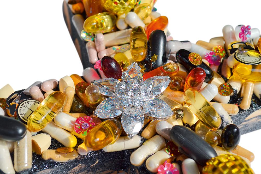 Vitamin Cross 2015 11.25 x 8.25 x 4 inches Glitter, vitamins, rhinestones, metallic stars, paper clocks, paillettes, & plastic on wood Collection of the Artist