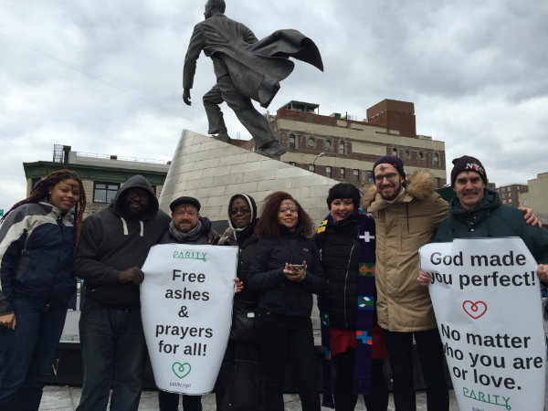 Parity staff and friends in front of a statue of Adam Clayton Powell on Wednesday, February 10th.