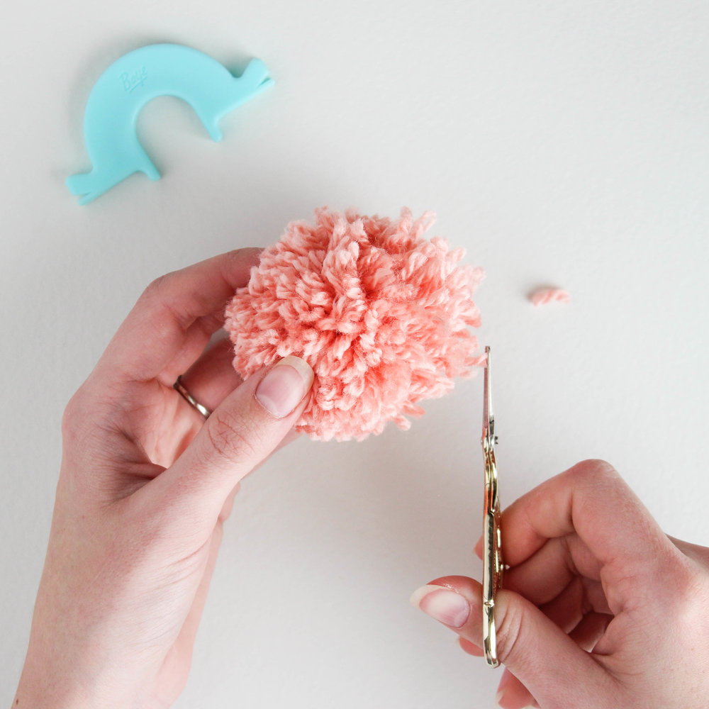 making a pom pom garland with boye pom pom maker // via www.darlingbebrave.com
