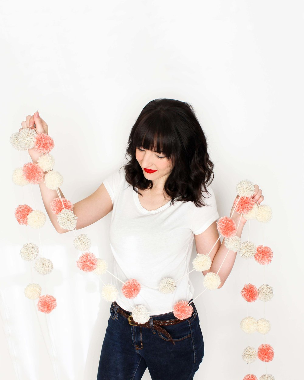 making a pom pom garland with new boye pom pom maker // via www.darlingbebrave.com