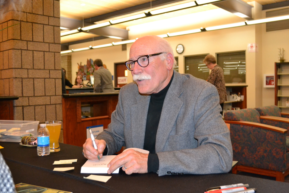 Following his remarks on April 2 at Benson Branch, Tobias Wolff signed copies of his works for A Novel Affaire attendees.