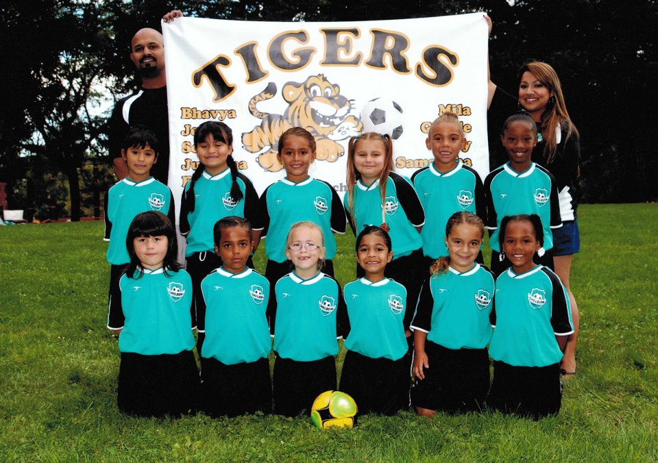 Go TIGERS!! We got this adorable picture in the mail from our little soccer team the Tigers! We custom design and print youth sports team banners, let us know if you are interested!