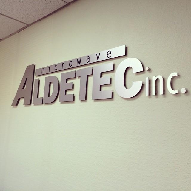 Custom indoor non illuminated brushed aluminum with standoffs for Aldetec Inc. (Sacramento).