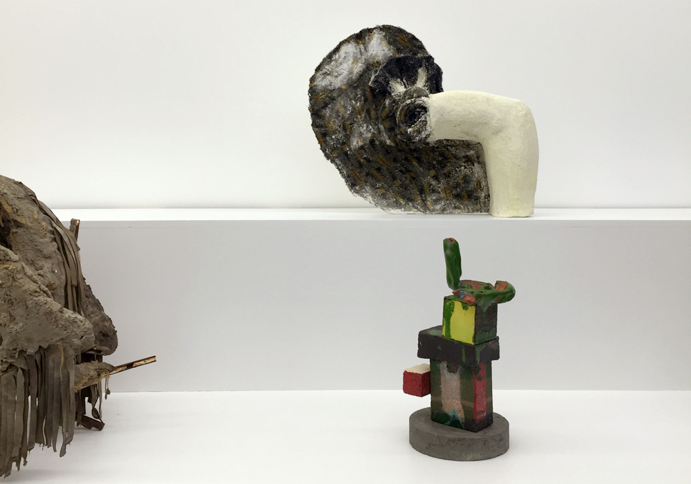 Top: Installation view with Ernesto Burgos'  Negative Nothing  (2014) and Michelle Segre's  Untitled (Bone)  (2013); Bottom: Installation view with Jennifer Paige Cohen's  Untitled (Green and Yellow Sweater)  (2014) and Arlene Shechet's  Hero  (2015);  Rock Hound Swap Meet , Junior Projects, NY. (Photos: Chris Murtha)