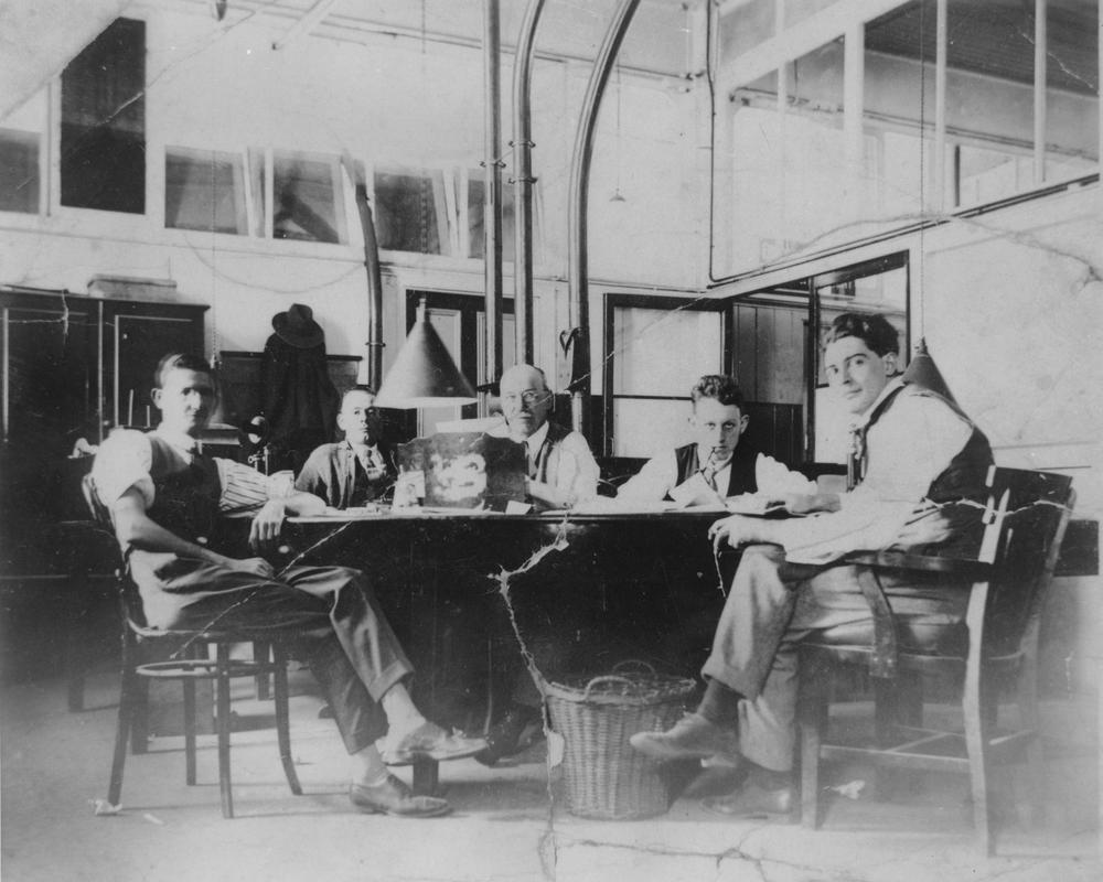 StateLibQld_2_164215_Sub-editor's_room_at_the_Brisbane_Courier_newspaper_office,_Brisbane,_1930.jpg