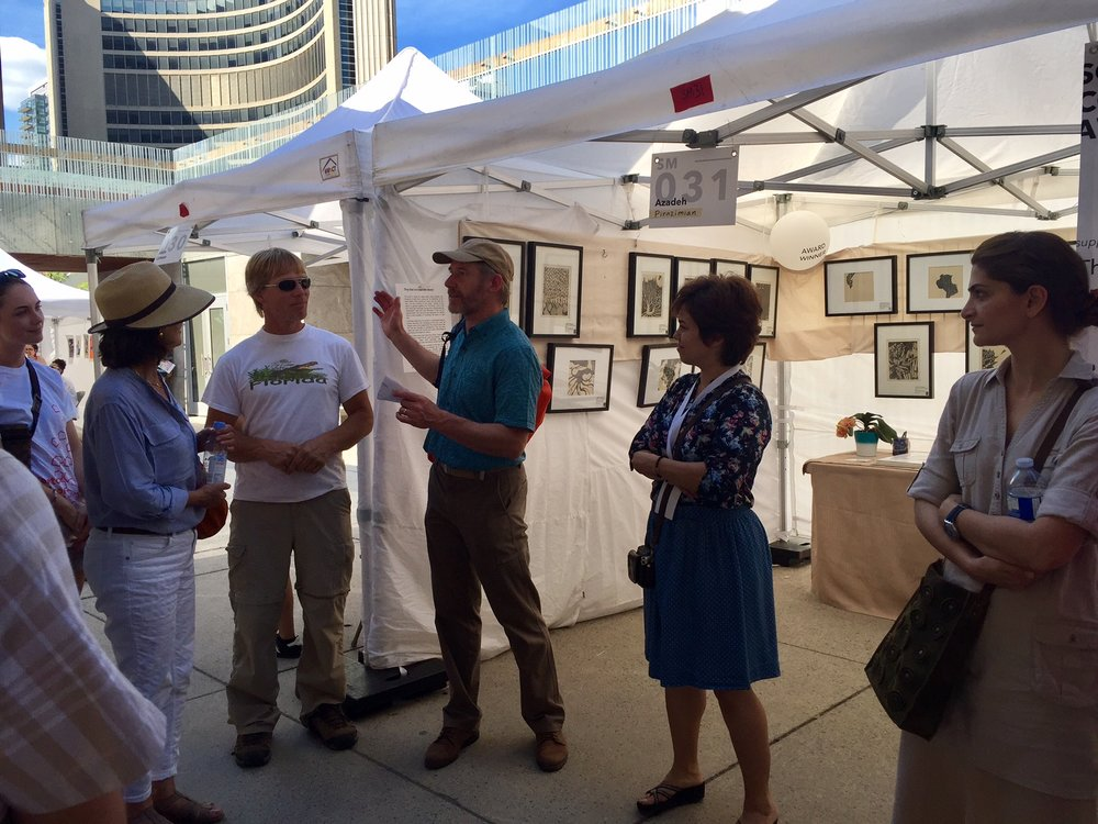 W. David Ward engaged the crowd during a tour of the TOAE grounds. Here, he stops at Pirazimian's booth.  (Photo: Andrew Williamson)