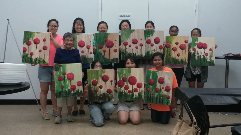 Maranatha ladies displaying their finished works of art